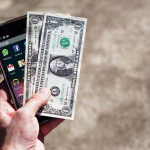 mobile phone money banknotes us dollars 163069.jpeg small